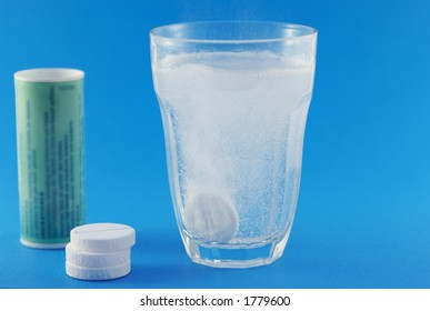Glass of water with medicine