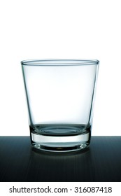 Glass of water on a black floor