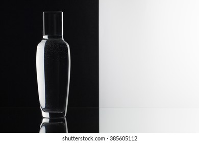 Glass of water on the black and white background on the glass table
