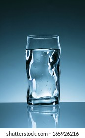 Glass of water on blue background