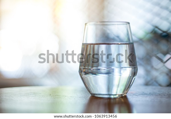 Glass Water On Glass Table Reflection Stock Photo Edit Now