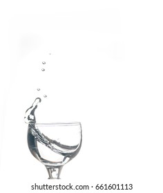 Glass with water on the white isolated background