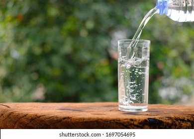 glass of water on wood table background