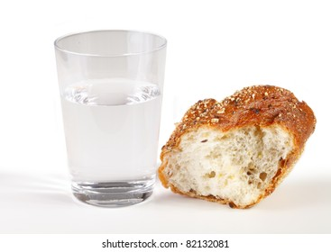 A glass of water with a piece of bread