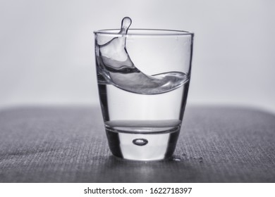 Glass water refreshing thirsty drink refreshment close up h20 drinking ripple splash cup of water