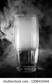 glass with water and smoke on a black background, abstrakt background