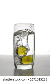 glass of water splash with ice
