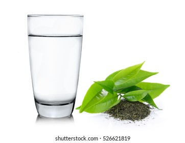 Glass of water and tea leaves ilsolated on white background