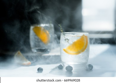 Glass of water that looks cool and refreshing. And orange slices in the glass