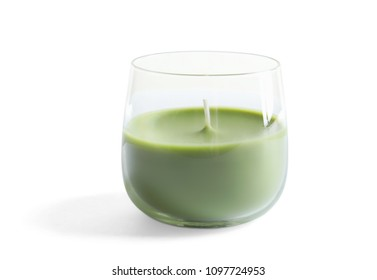 Glass with wax candle on white background
