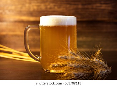 A glass of wheat beer on a beautiful wooden background