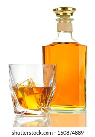 Glass of whiskey with bottle, isolated on white