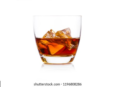 Glass of whiskey with ice cubes on white background. Cognac and brandy drink