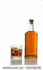 a glass of whiskey with ice isolated on white background