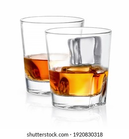 Glass of whiskey with ice on a white background