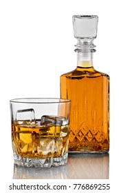 Glass of the whiskey with ice and a square decanter isolated on a white background with reflection