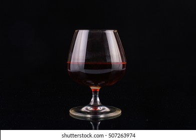 Glass of whiskey on a black background