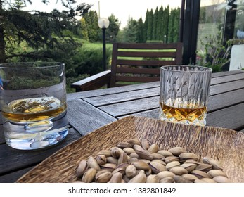 glass of whiskey on table at garden