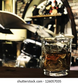 glass of whiskey on the table in jazz bar