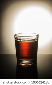 Glass of whiskey on the table / taken at the personal Studio of a photographer