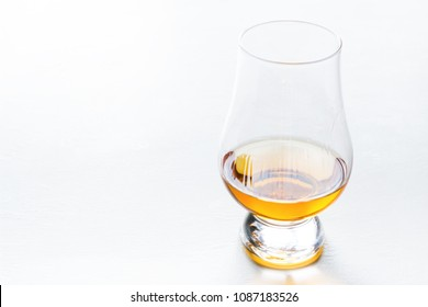 glass for whiskey on white background with place for text