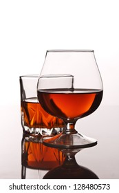 glass of whiskey on white background
