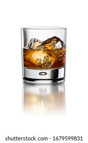 Glass with whiskey on the white background with ice isolated with clipping path