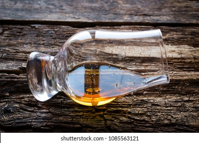a glass of whiskey on a wooden background close-up