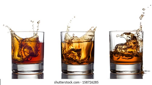 Glass of whiskey solated on white background