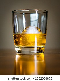Glass of whisky and ice