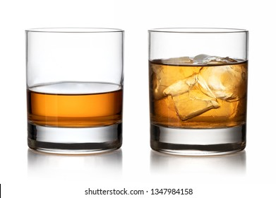 Glass of whisky and ice isolated white background