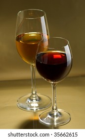 Glass white and red wine on a bronze background