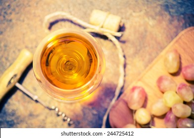 Glass of white sweet dessert wine with grapes