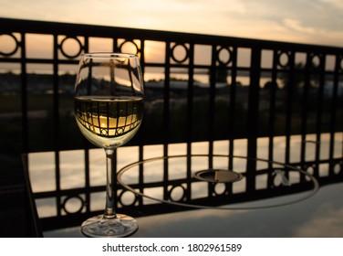 Glass of white wine at balcony near Blaine moorage, Washington