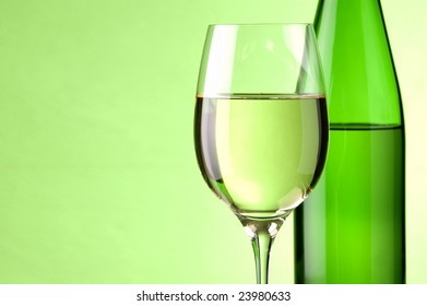 a glass of white wine and a bottle