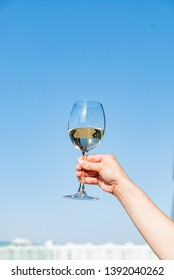 glass of white wine in the hand