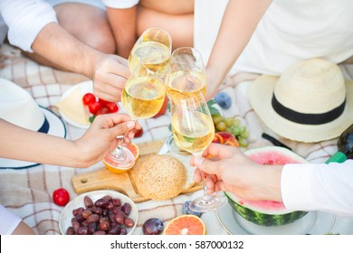 Glass of white wine on picnic table.  Dining People Concept.