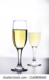 glass of white wine on a table on a white background isolate