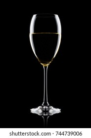 Glass of white wine with reflection on black background