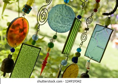 Glass wind chime hanging outside, shallow focus