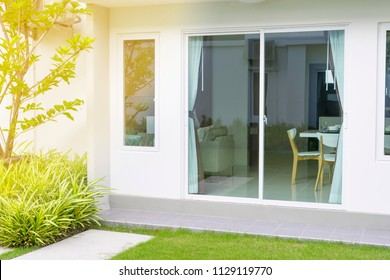 glass window door open to the private garden of the home