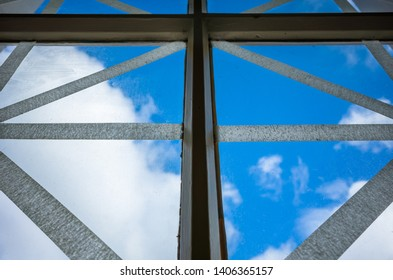 A glass window pane taped to avoid shattering and splinters.