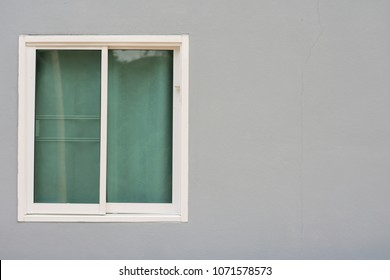 Glass window sliding on gray wall interior house.