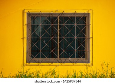 Glass windows with wrought iron, yellow wall panels