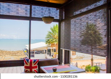 Glass windows,Roller blind sun protection and sea View.