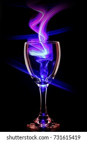 Glass of wine abstract colored lights in motion