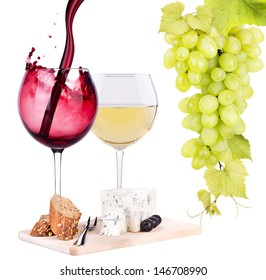 glass of wine, assortment of  cheese and grapes isolated on white