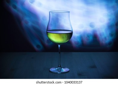 A glass of wine with a club effect of light