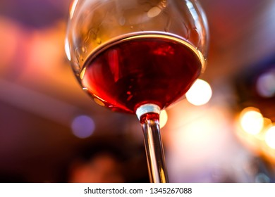 Glass of wine detail with blurry background closeup