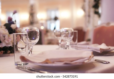 Glass wine glasses on the table served for the reception in the restaurant